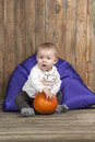 Baby with pumpkin Stock Image