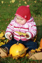 Baby with pumpkin & leaf Stock Photo