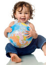 Baby with puzzle globe. Royalty Free Stock Photo