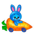 Baby rabbit and car carrots Stock Images