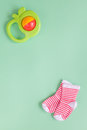 Baby rattle on green background Royalty Free Stock Photo