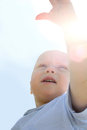 Baby Reaching for the Sky Royalty Free Stock Photo