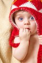 Baby in red bonnet blue eyed Stock Photo