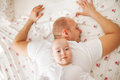 Baby relaxing on his father s back cute boy is relaxin the of Stock Images