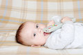 Baby with remote control lovely age of months Royalty Free Stock Photography