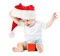 Baby removes his santa hat Royalty Free Stock Photo