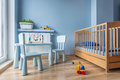 Baby room in light blue color Royalty Free Stock Photo