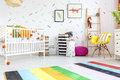 Baby room with yellow chair Royalty Free Stock Photo