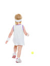 Baby running for tennis ball rear view isolated on white Stock Image