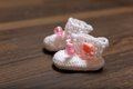 Baby's bootee on wooden Royalty Free Stock Photo