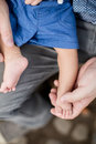 A baby's feet being held by ather's hand. Royalty Free Stock Photo