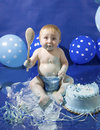 Baby s first cake smash party birthday a boy smashing his birthday Royalty Free Stock Images