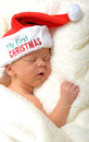 Baby s first christmas a newborn sleeping in a santa hat Royalty Free Stock Photography
