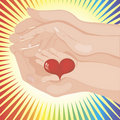 Baby's hand holding a heart between parents' Royalty Free Stock Photo