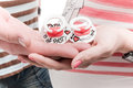 Baby`s nipples in the hands Royalty Free Stock Photo