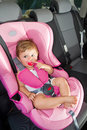 Baby in a safety car seat. Royalty Free Stock Image