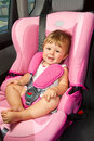 Baby in a safety car seat Stock Photography