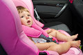 Baby in a safety car seat safety and security Royalty Free Stock Photography