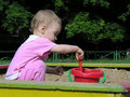 Baby in sandbox Stock Image