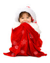 Baby santa in a gift sack Stock Images