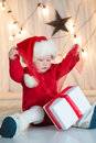 Baby santa with giftbox cute Royalty Free Stock Photography