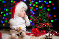 Baby in Santa hat on bright background Royalty Free Stock Photography