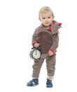 Baby in Santas deer costume holding alarm clock Royalty Free Stock Photos