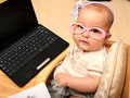 Baby secretary a caucasian with laptop Stock Image