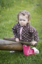 Baby and the seesaw toddler sitting on outdoor portrait Stock Image