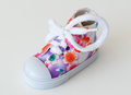 Baby shoe sneaker colorful girl closeup Stock Image