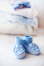 Baby shoes for boy on a blue background Royalty Free Stock Photo