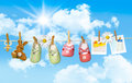 Baby shoes, pacifier and teddy bear on clothesline Stock Photo