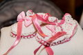 Baby shoes with pink ribbons Stock Photos