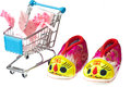 Baby shoes and socks tiger girl in shopping trolley Stock Images