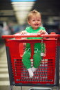 Baby in shopping cart Royalty Free Stock Photo