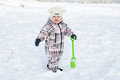 Baby with shovel in winter lovely year Stock Image