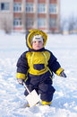 Baby with shovel in winter warm dressed year outdoors Stock Photos