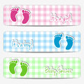 Baby shower banners with footprints and checkered background Stock Images