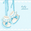 Baby shower card with blue booties and lace Royalty Free Stock Photography