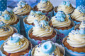 Baby shower cup cakes blue with different style decorations Stock Photo