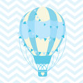 Baby Shower illustration with cute blue hot air balloon on chevron background Royalty Free Stock Photo