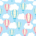 Baby shower seamless pattern with cute hot air balloons on blue sky