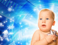 Baby with a silver star Royalty Free Stock Photography