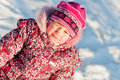 Baby sits on snow portrait Stock Photography