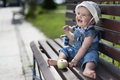 Baby sitting on the bench Royalty Free Stock Image