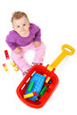 Baby sitting on floor with brick toys over white Stock Image