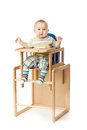 Baby sitting in highchair. Royalty Free Stock Images