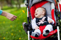 Baby in sitting stroller Stock Photography