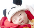 Baby sleep boy in panda hat in deep Royalty Free Stock Photo