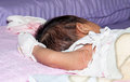 Baby sleep little in a diaper sleeping on mattress Royalty Free Stock Photos